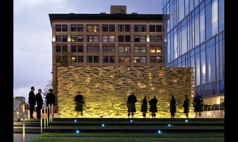 At night, integrated uplighting makes the Los Angeles Police Department Memorial to Fallen Officers appear to hover above its stone base.