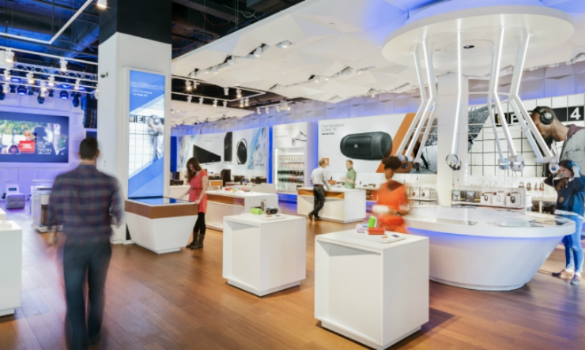 The store design is customer-focused and holistic, integrating architecture with brand and digital technology.