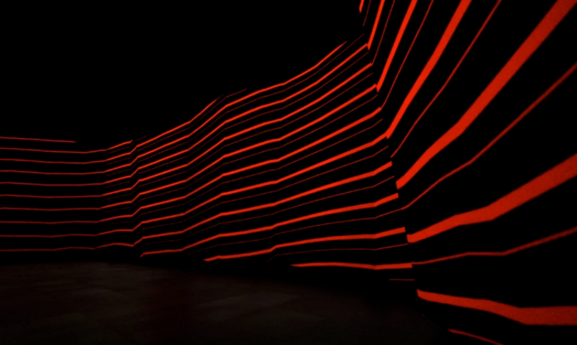 Once inside, visitors enter a sensory decompression chamber created with a tunnel of bright LED walls and directional sound.