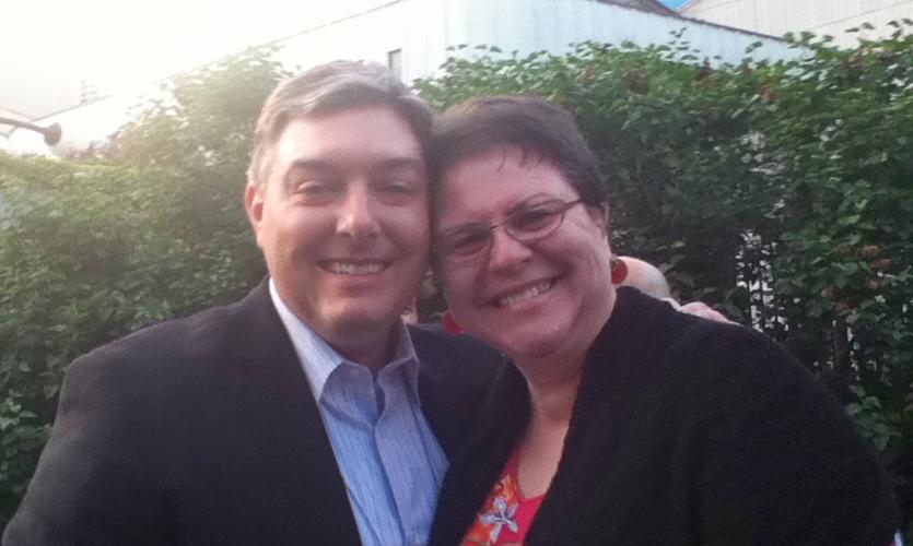 Past Board President John Lutz (Selbert Perkins Design) poses with past COO/CEO Ann Makowski
