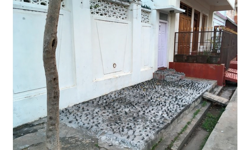 Hostile Design: Around this town, sharp little stones inset in the cement are used as a way to prohibit standing or sitting or lying on the surface.