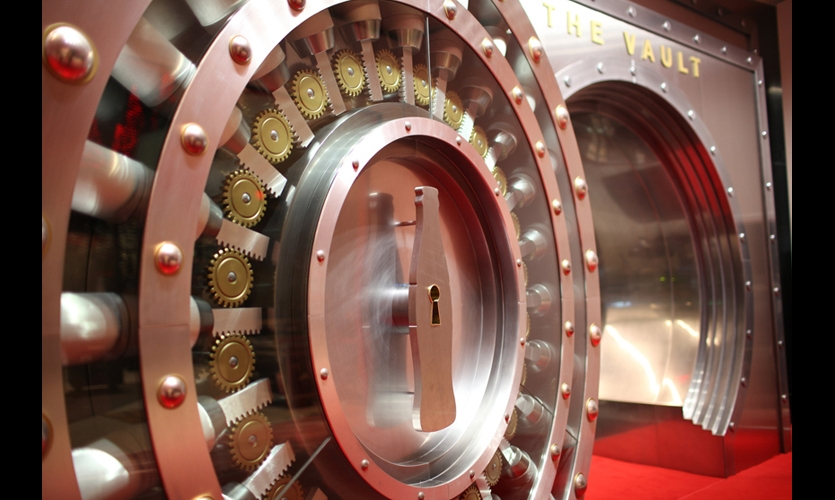 Few objects spark an aura of intrigue like the door of a vault. Fantastic in its massive, stylized, impenetrable appearance, this portal draws guests into the High Security Zone surrounding the home of the Secret Formula at the World of Coca-Cola in Atlanta. (Photo: Second Story Interactive)