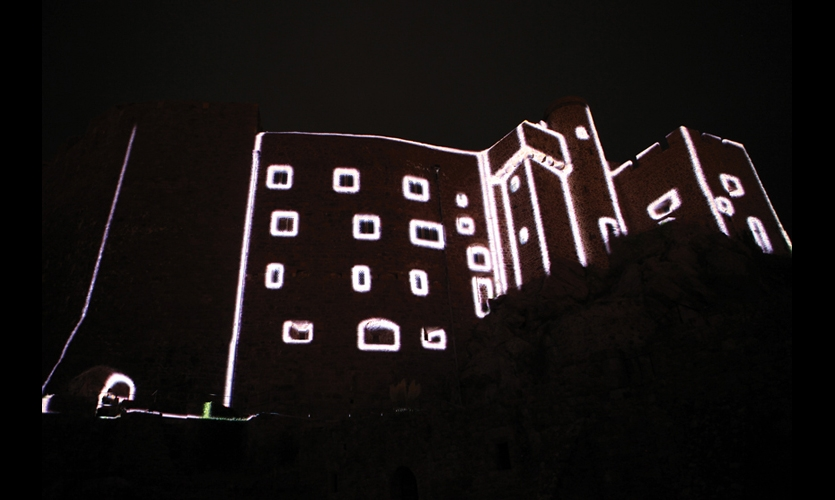 At first the show seem to simply illuminate the contours of the facade.
