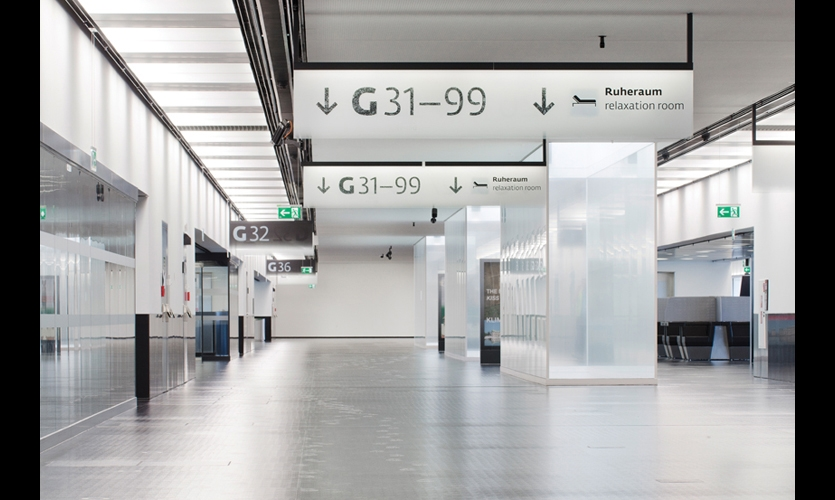 The black-and-white system allowed the introduction of a simple way finding logic: follow the white signs through the terminal until you find the black signs, at the gate and beyond.