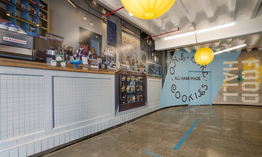 Airspace used hand-painted text and murals as well as digitally-printed and temporary graphics for up-and-coming retailers.