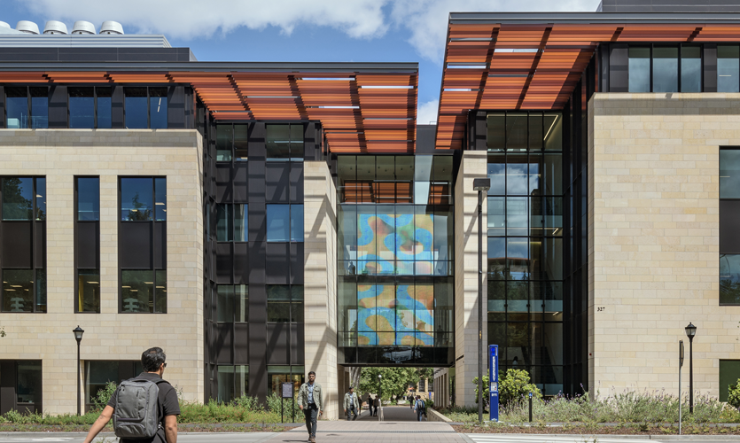 The video art piece spans a major campus pedestrian axis, Discovery Walk, drawing visitors into a new science precinct.