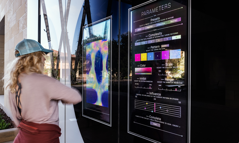 The touch sensitive interface functions as a video synthesizer, allowing users to control every parameter of a six-layered interactive Turing pattern.