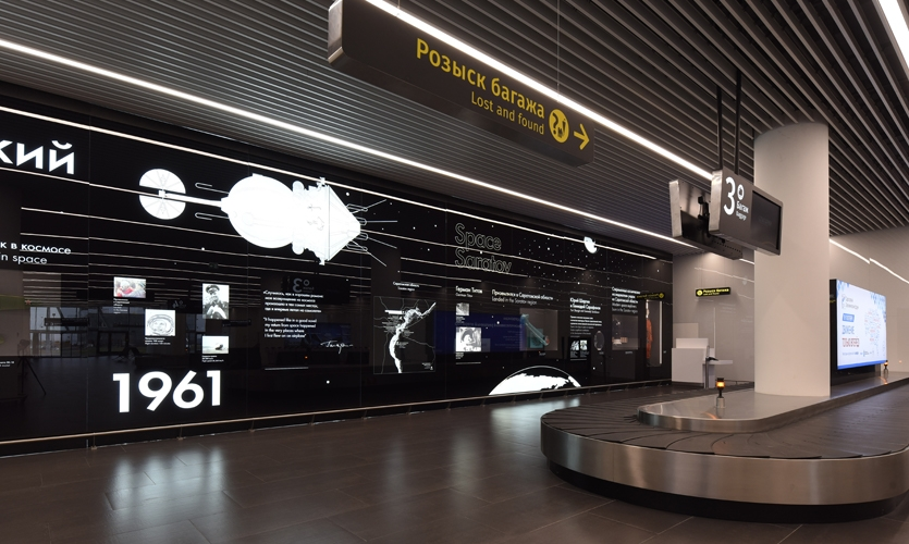 On a glass wall in arrivals, the story of space exploration in the context of Saratov is told.
