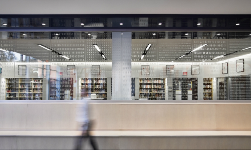 The glass wall of the library features 10 unique codes, each arranged as a pattern on its own panel of glass. (Photo: Garrett Rowland)