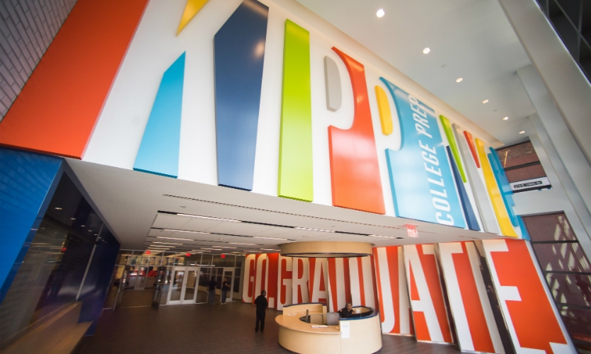 Students see the first puzzle as soon as they enter the school, where the name is rendered in a colorful supergraphic of positive and negative space that plays with perception. (Photo: Rob Bennett)