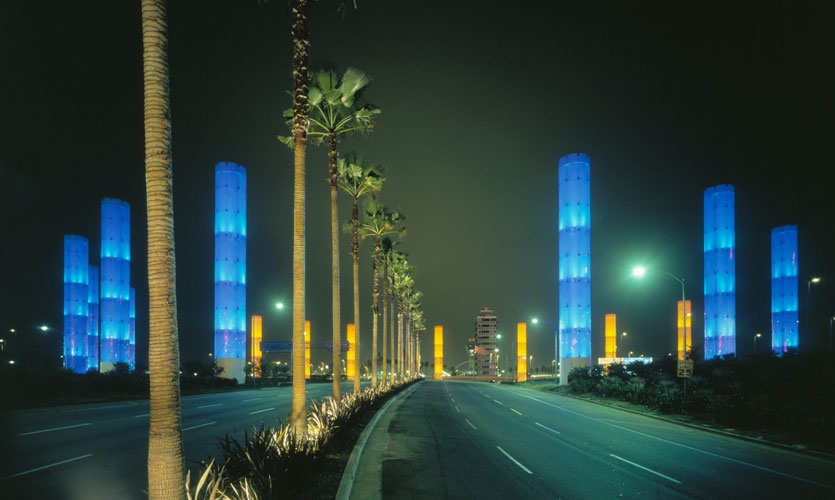 The iconic LAX Gateway has become an icon of the LA experience. Conceived and designed by SPD in collaboration with the LAX Beautification Team, the landmark gateway features a ring of fifteen illuminated 100′ color-changing columns.