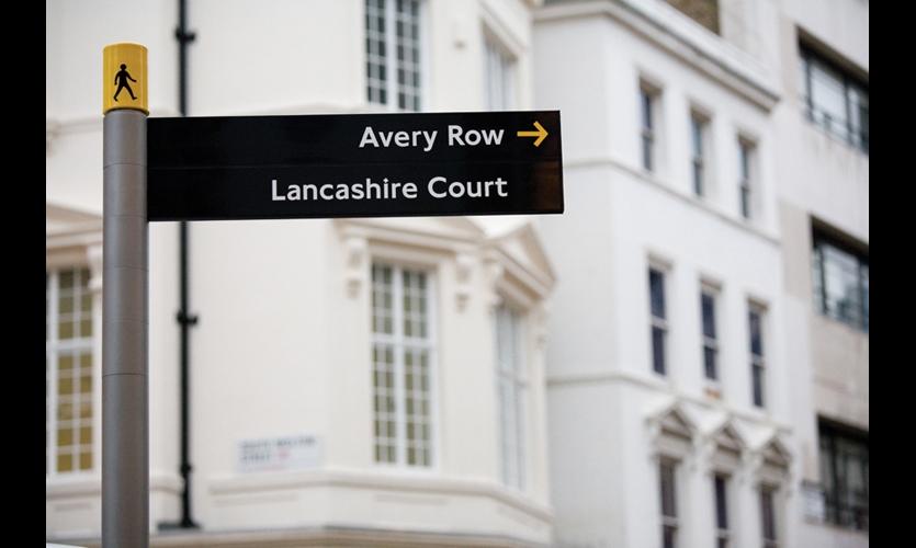 Fingerpost signs incorporate the familiar Legible London walker icon.