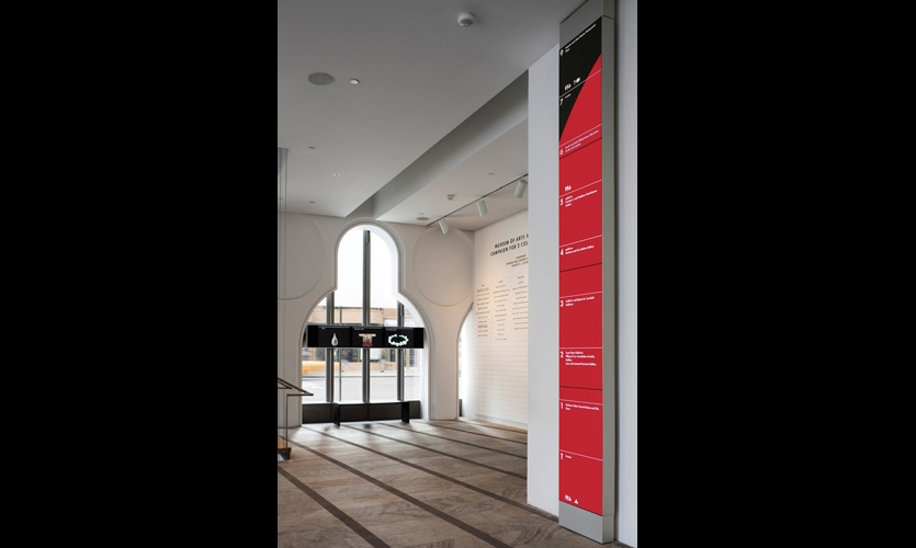 The iconic 2- by 14-ft.-tall wayfinding totem is a dynamic floor directory that combines wayfinding and programming information in a dramatic visual presentation.