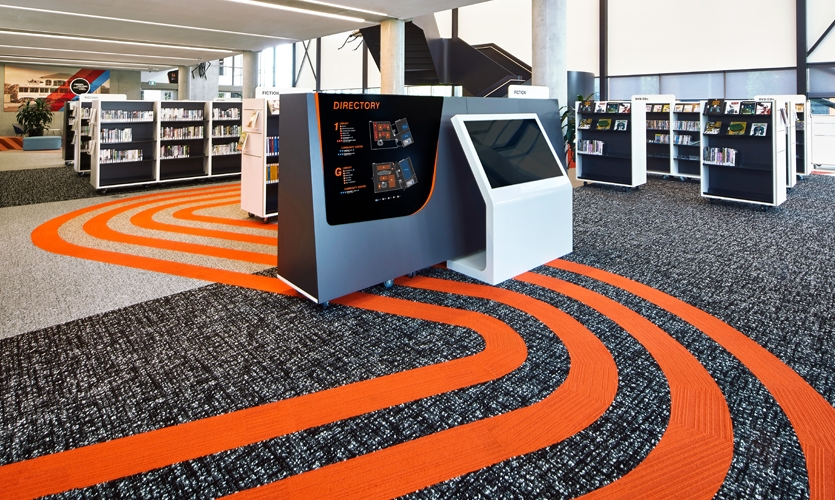 The entire wayfinding system is rich with graphic cues at every turn that embody speed and dynamism. (image: library with racing stripes)