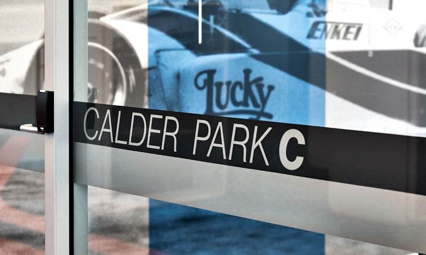 The graphics pay homage to the different vehicles and events the racetrack played home to. (image: room identification signage)