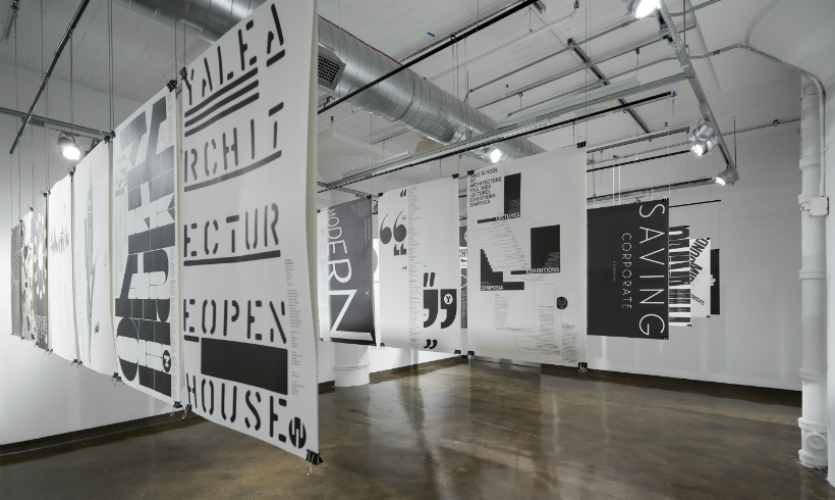 Posters in his ongoing series for the Yale School of Architecture are hung dramatically in another gallery. (Photo: Bilyana Dimitrova)