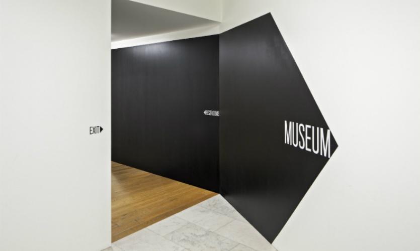 Bold black and white wayfinding elements help visitors navigate through construction detours.