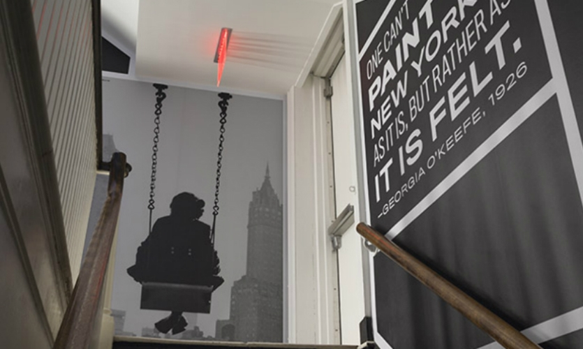 In a separate project, Pentagram covered nearly every inch of the museum's back stairwell with iconic photos of NYC scenes.