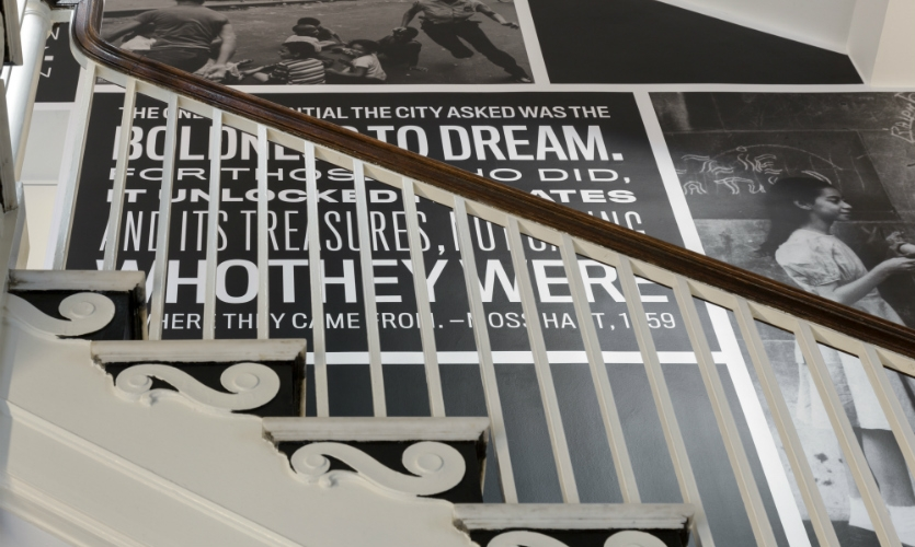 The graphics aid circulation by encouraging visitors to use the back stairwell.