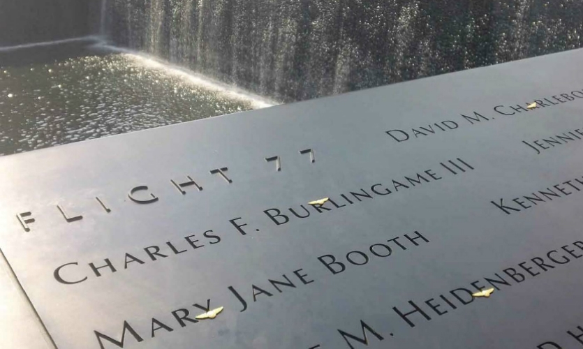 (2011) The final iteration of the victims names commemoration, created by Michael Arad, retains our raised prismatic lettering for FLIGHT 77. The names in Arad's final version were hydro-cut, stencil secured, rendered in Optima lettering (as opposed to the custom font of our prototypes) and illuminated from below on a machined, homogenous-finish panel.