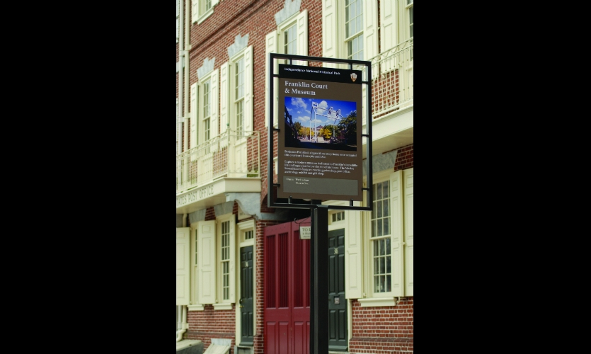 Sign structures are contemporary versions of colonial tavern sign frames.