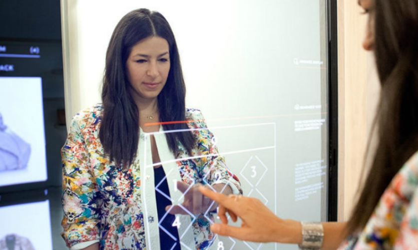 Retail is innovating customer experience in fun ways, like the smart dressing room for fashion brand Rebecca Minkoff. The room is equipped with Kinect sensors, a touchscreen, music and lighting controls, and sophisticated tracking. (Photo: FastCompany)