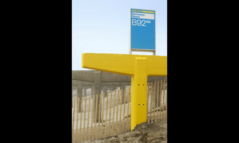 Beach ID signs are accompanied by highly visible markers along the shoreline, mounted on the stanchions left when the hurricane swept boardwalks away.