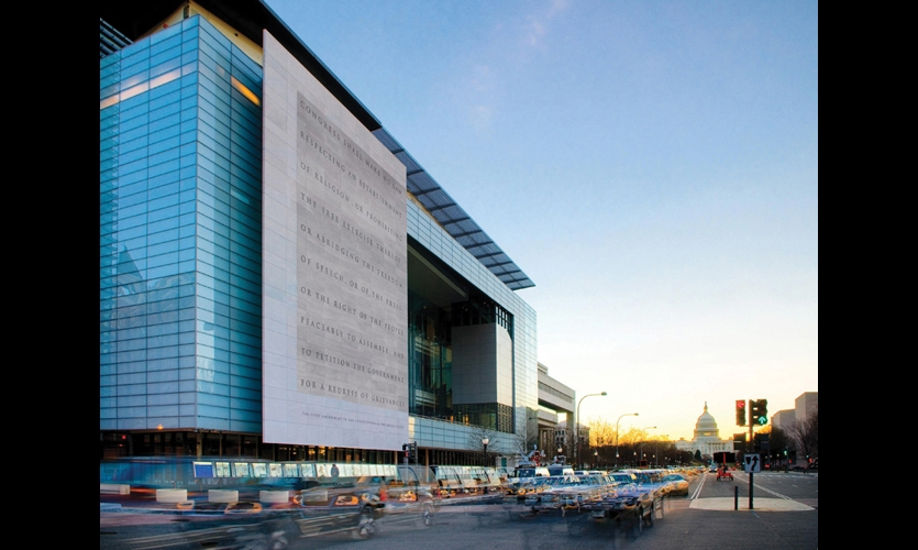 The 45-word text of the First Amendment is carved into the marble slab on the facade of the Newseum. The building was designed by Polshek Partnership Architects.