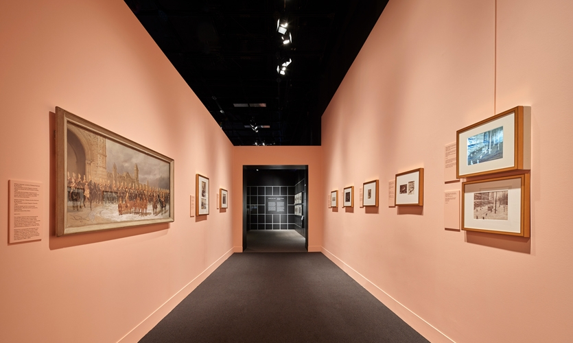 Halfway through an exhibition that adheres to the black and white color schemes available to 19th century photographers, visitors are plunged into a pink space.