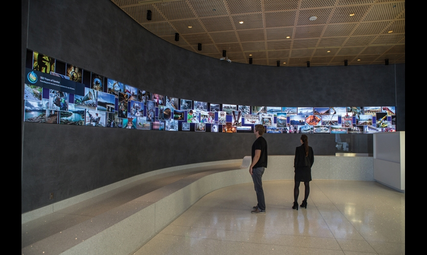 The Digital Arts Wall is a 4-ft.-tall, 58-ft.-long digital canvas integrated into the building's curved lobby walls. It is comprised of 160 Christie MicroTile displays. (Photo: Obscura Digital)