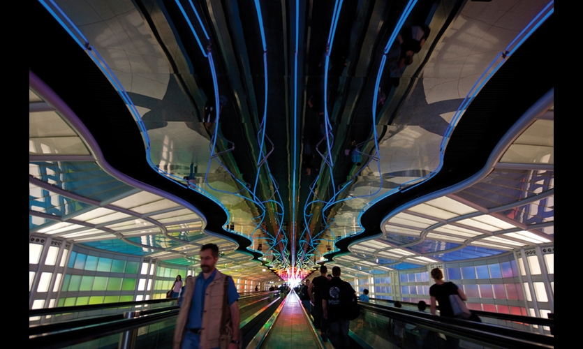 United Airlines O'Hare Airport Walkway (1987). Michael Hayden's Sky's the Limit shaped neon sign technology into a moving spatial experience. Now redone with LEDs, the 750-foot-long sculpture still creates an engaging visitor experience. (Photo: City of Chicago)