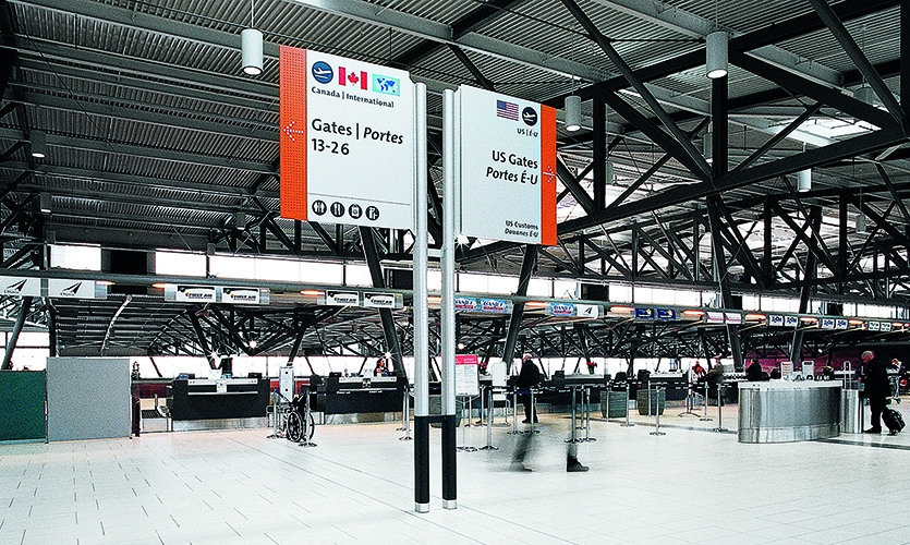 Ottawa Airport: They balanced the scale, form, illumination, color and design of the wayfinding system to integrate with architectural design of the airport overall.