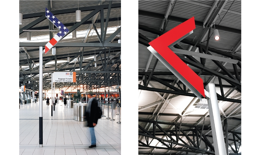 Ottawa Airport: In order not to impede the sightlines in this mid-sized airport, they developed a system of post- and-panel signs for Canadian and International flights. One made up of stars and stripes, directs travelers to US flights.