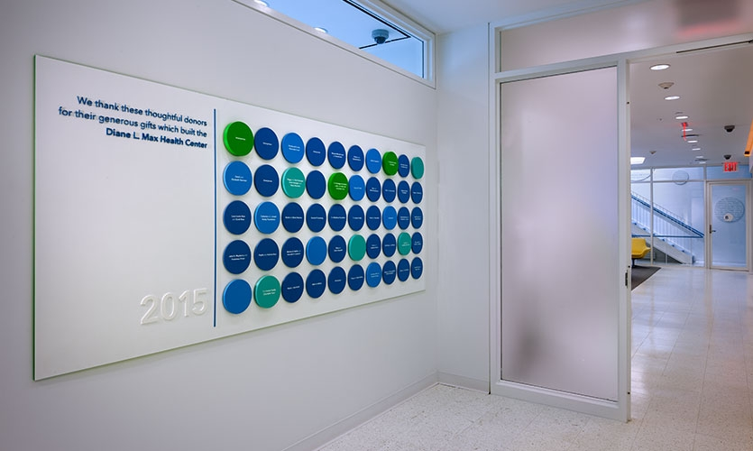 The donor wall, with names etched onto 1/8-in. aluminum discs affixed to acrylic discs. (Names of donors have been intentionally altered at the request of PPNYC.)