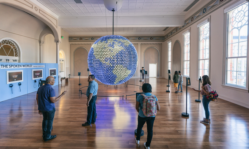 """The Spoken World"" gallery features a 12-foot-diameter interactive sphere covered in 4800 LEDs activated by 12 iPads. Photo credit: Planet Word"