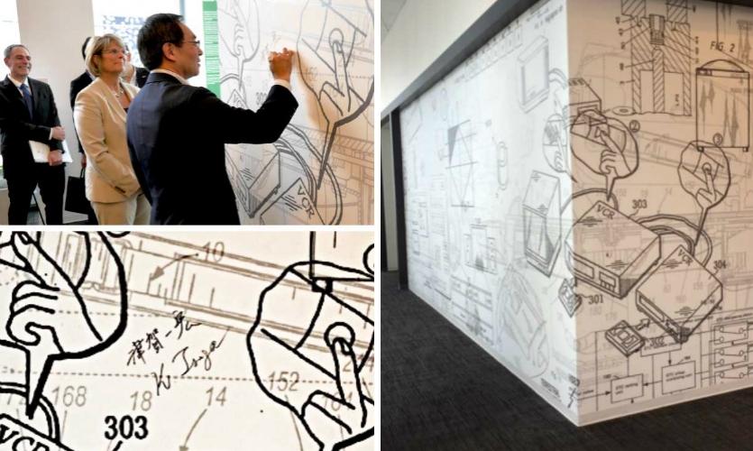 Quando Panasonic CEO Kazuhiro Tsuga visitou a nova sede, ele autografou a parede que caracteriza suas patentes.
