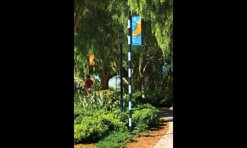 Since the park's public art is literally up in the trees, Visual Asylum designed banner poles to guide visitors' eyes upward.