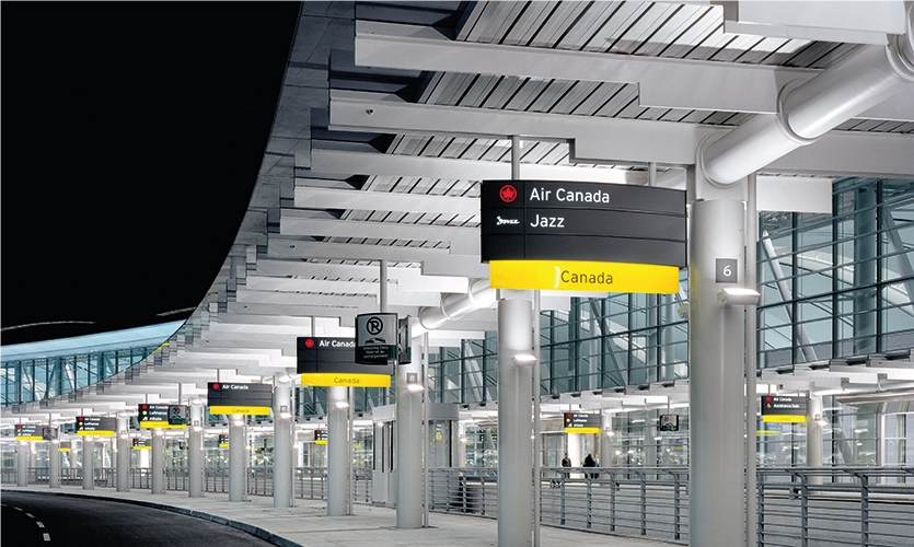 Toronto Pearson International Airport: Color-coding was used to help with orientation throughout with arrivals in green and departures in yellow.