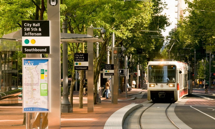 Portland Transit Mall Redevelopment: Stainless steel clad columns serve as armatures for transit signage, lighting and security cameras.