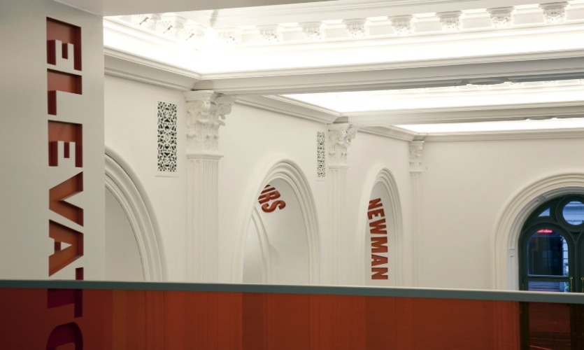 Plaster archways feature routed and painted, knocked-out text.