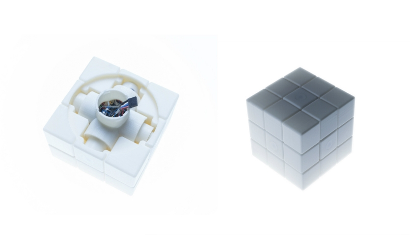 The interface cube was 3D printed. It can be taken apart and its electronics and battery fit into its core.