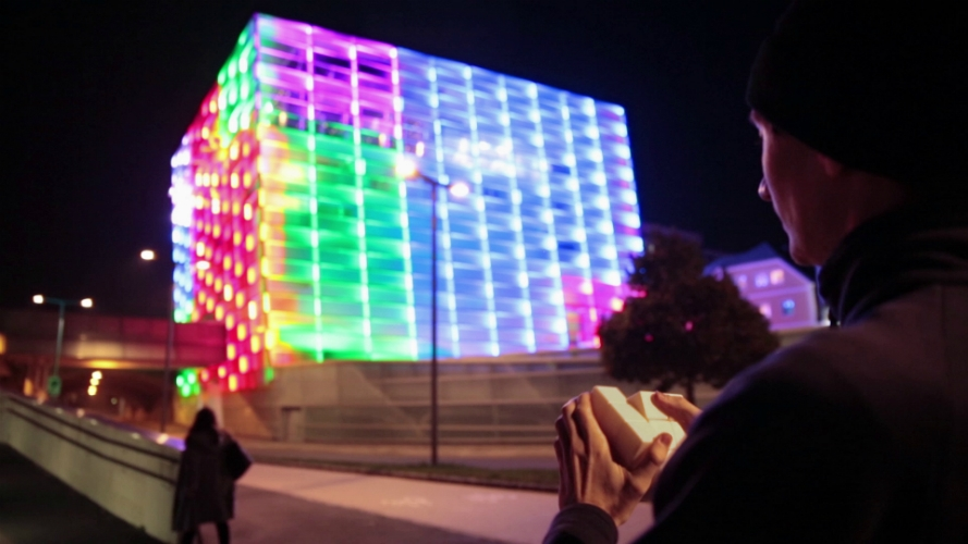 These data were sent over Bluetooth to a computer that runs custom Puzzle Façade software that changes the lights and colors on the media façade in correlation with the handheld interface cube.
