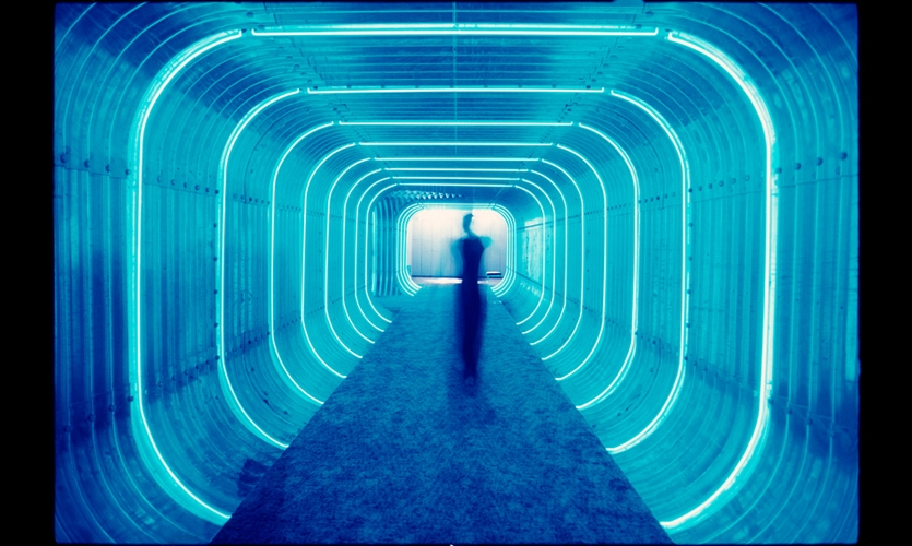 (1968) Rudolph de Harak transformed 127 John Street's generic architecture with an entrance tunnel illuminated by rings of blue argon-gas-filled tubes. He used color as wayfinding cues: bright blue to guide visitors to the low-rise side of the building, and red for the high-rise side. (Photo: Poulin + Morris)
