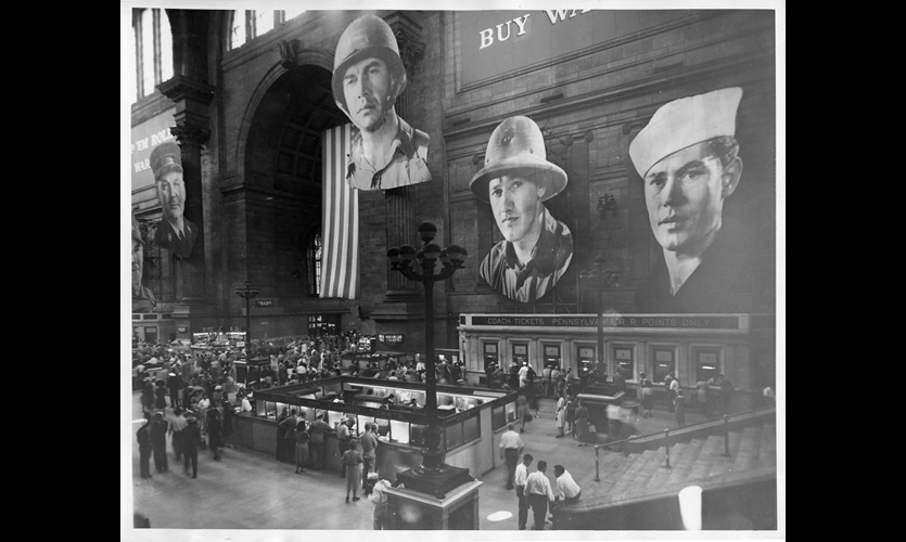 (1945) Raymond Loewy's inventive WPA mural at Penn Station in New York City was composed of a series of large-scale cut-out photographic portraits that provided a dramatic backdrop for patriotic typographic messages. It was one of hundreds of WPA murals used to promote war efforts and employ artists and designers. (Photo: New York Transit Museum)