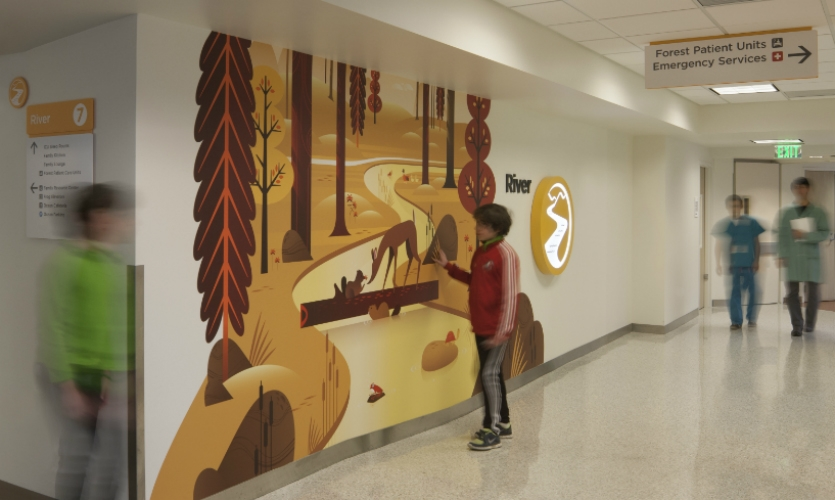Wayfinding zones are reinforced by colors and themed art.