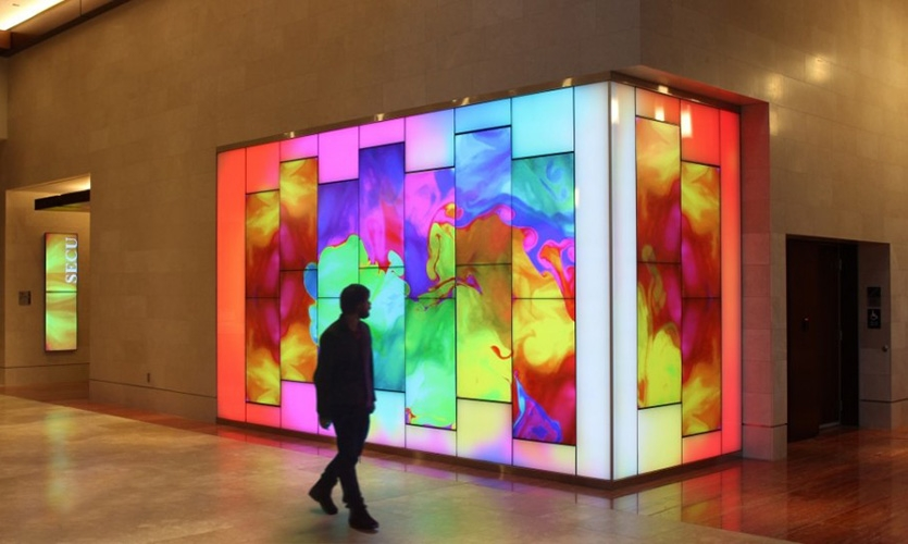 A gesturally interactive art video wall by Materials & Methods for the State Employee Credit Union in Raleigh, NC.