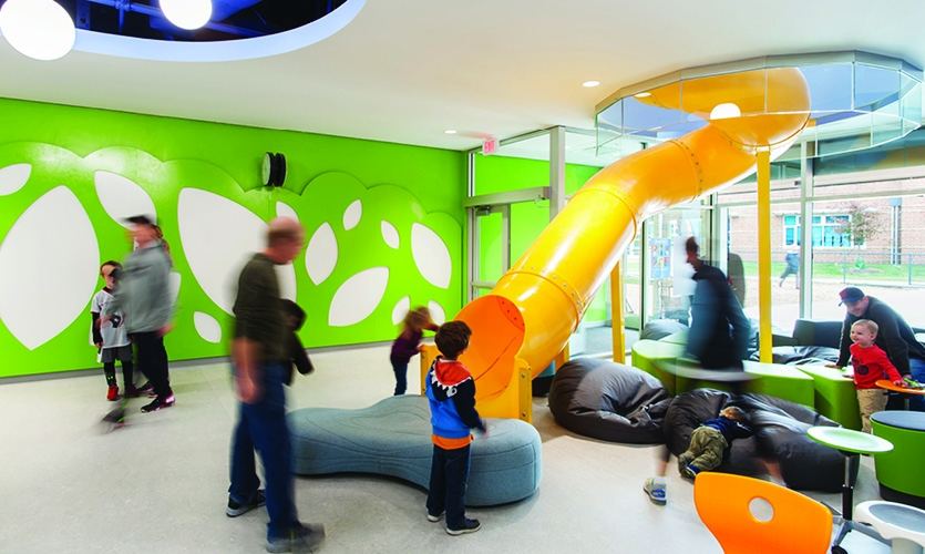 Common spaces have dry-erase and magnetic portions which help Teachers expand the learning experience outside the classroom, and a slide brings fun activity into the environment.   (Photo: Lincoln Barbour)