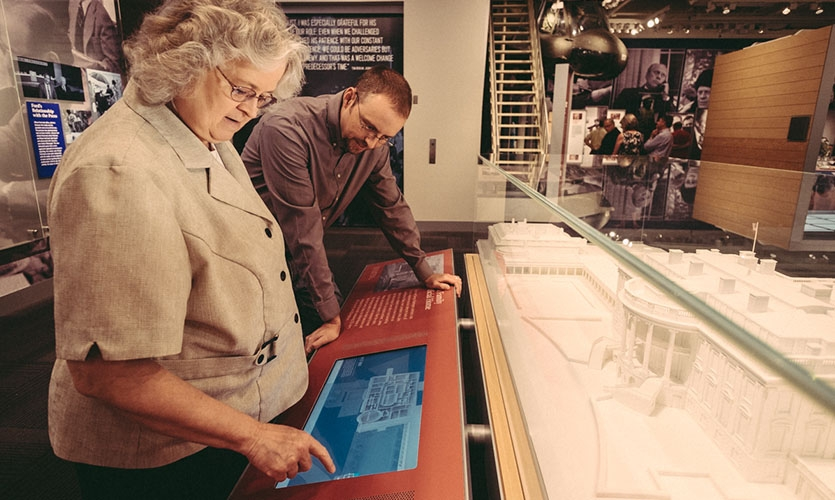 Visitors explore a user-controlled 3-D fly-through of the White House with details from the Ford Administration's time there.