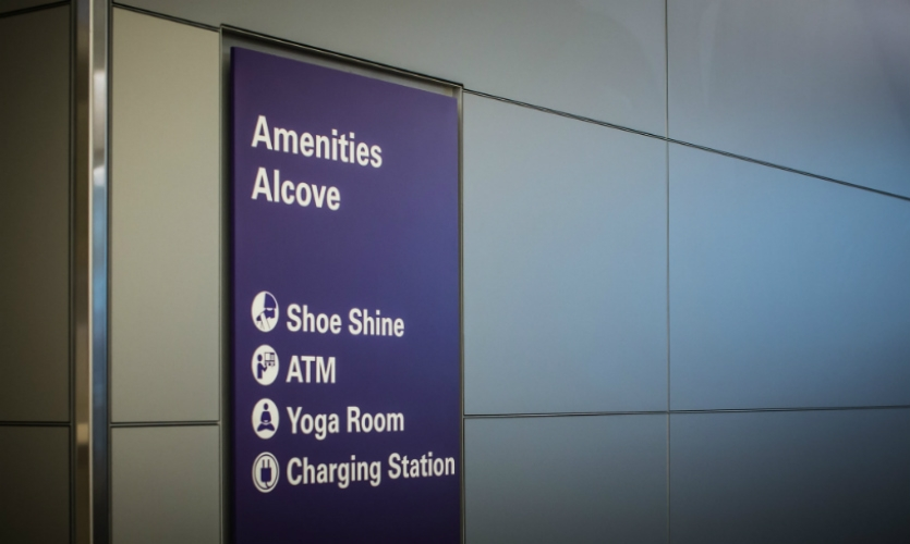 Amenities are highlighted on purple signs. (SFO was the first airport with a yoga studio on premises.)