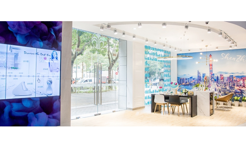 Potential business partners can learn about the company's history and get a feel for products. (image: interactive timeline wall and seating area)